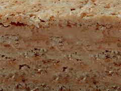 ЭСТЕРХАЗИ - несколько ореховых слоев на основе миндаля и взбитого белка с прослойками сливочно-масляного крема с миндальной крошкой, пралине и коньяком.